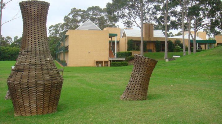 The ground of MGSM north ryde with wicker material artwork pieces decorating the area